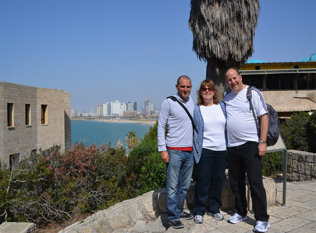 Dan and his parents in Jaffa, overlooking the Tel Aviv skyline.